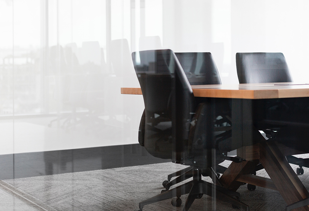 Empty boardroom with table and chairs