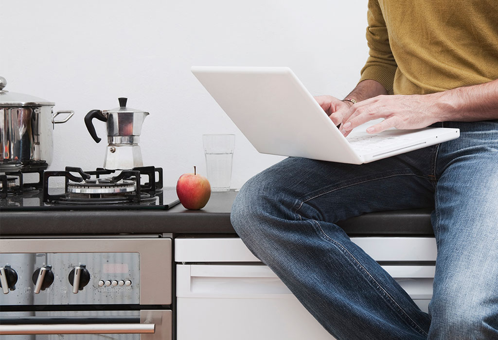 Person sitting on kitchen counter