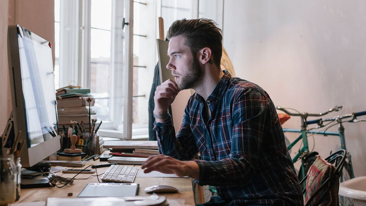 Man working from home office in casual clothes